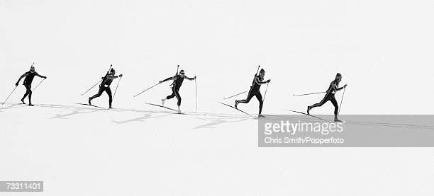 View of a team competing in the Relay Biathlon event at the 1980 Winter Olympics at Lake Placid Olympic Sports Complex Cross Country Biathlon Center...