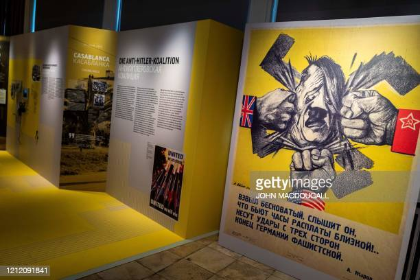 View of a temporary exhibition featuring a caricature of Nazi leader Adolf Hitler titled From Casablanca to Karlshorst detailing important stages in...