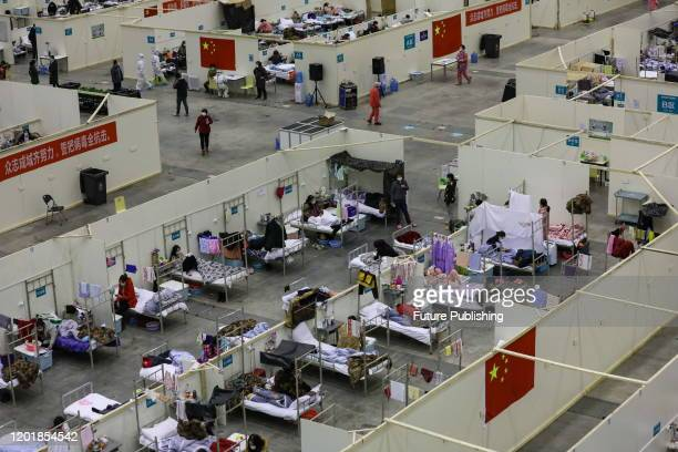 View of a temporary hospital situated in an exhibition center in Wuhan in central China's Hubei province Tuesday, Feb. 18, 2020. The hospital, one of...