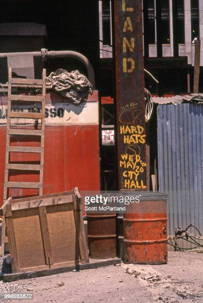 View of a text in yellow paint on a steel beam outside an unspecified construction site in downtown Manhattan New York New York May 1970 The text...