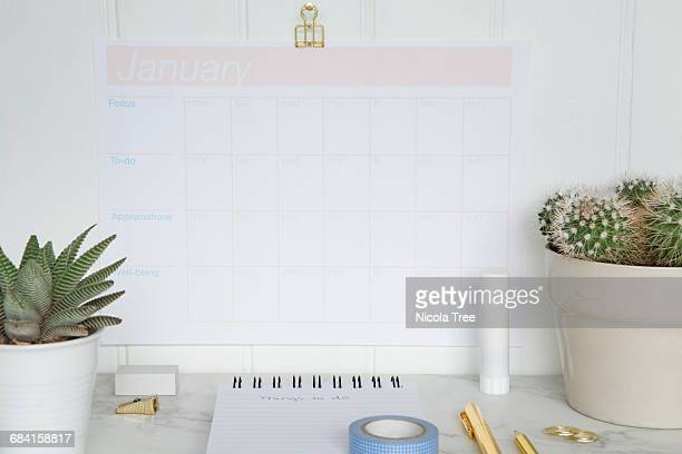 View of a tidy desk with planners and calenders