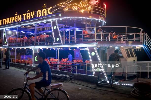 A view of a tourist boat which travels along the Han river in the habour in the city center on January 26 2019 in Danang Vietnam Vietnam appears to...