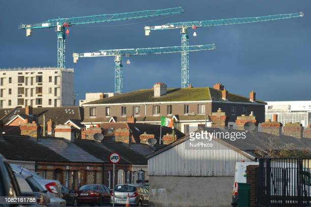 A view of a traditional architecture in Irishtown and a construction site and cranes near a Quay on the banks of the River Liffey seen from Irishtown...