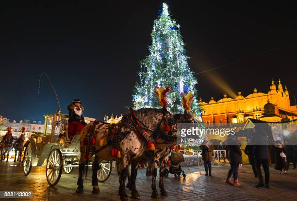A view of A traditional carriage seen near Mariacki Basilica in the Market Square in Krakow in Krakow's Main Square On Thursday December 7 in Krakow...
