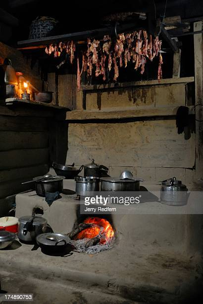 View of a traditional Nepali cooking stove with meat drying above at a guest house in the village of Sirikhola a stop along the Sandakphu Trail The...