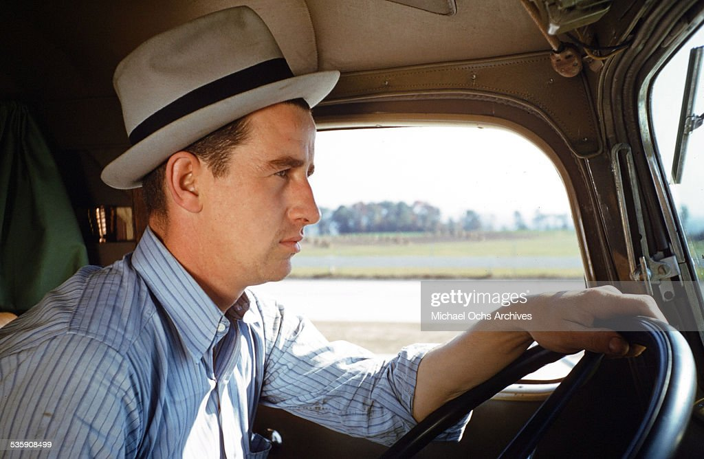 A view of a truck driver, as he drives a Mack Truck for Cooper Jarrett Motor Freight Lines in Illinois.