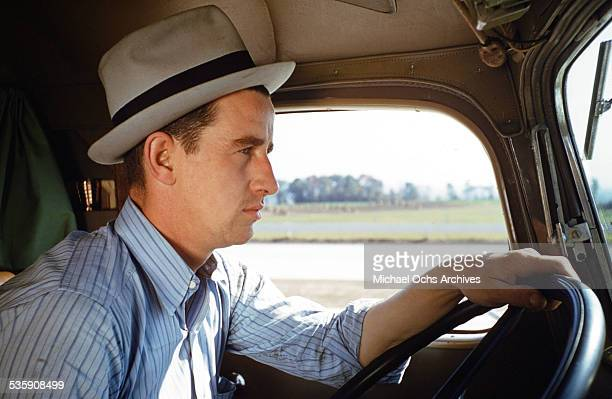 A view of a truck driver as he drives a Mack Truck for Cooper Jarrett Motor Freight Lines in Illinois