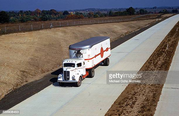 A view of a truck driver drives a Mack Truck down the interstate for Cooper Jarrett Motor Freight Lines in Illinois