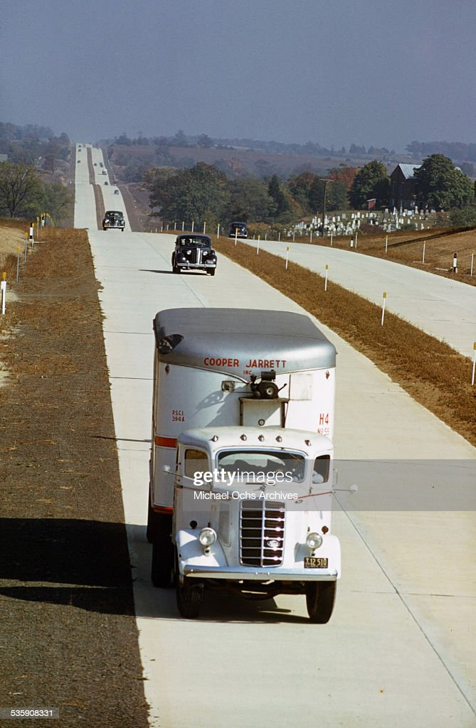 A view of a truck driver driving a Mack Truck down the interstate for Cooper Jarrett Motor Freight Lines in Illinois.