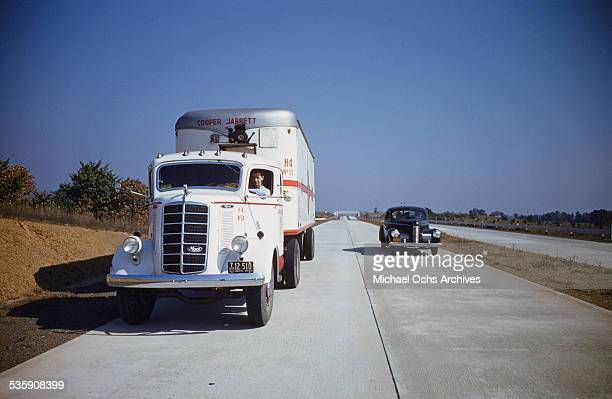 A view of a truck driver driving a Mack Truck down the interstate for Cooper Jarrett Motor Freight Lines in Illinois