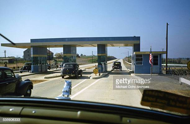 A view of a truck driver driving a Mack Truck through a toll for Cooper Jarrett Motor Freight Lines in Illinois