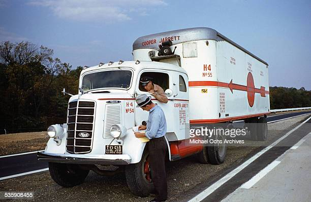 A view of a truck driver parking a Mack Truck alongside the interstate for Cooper Jarrett Motor Freight Lines in Illinois