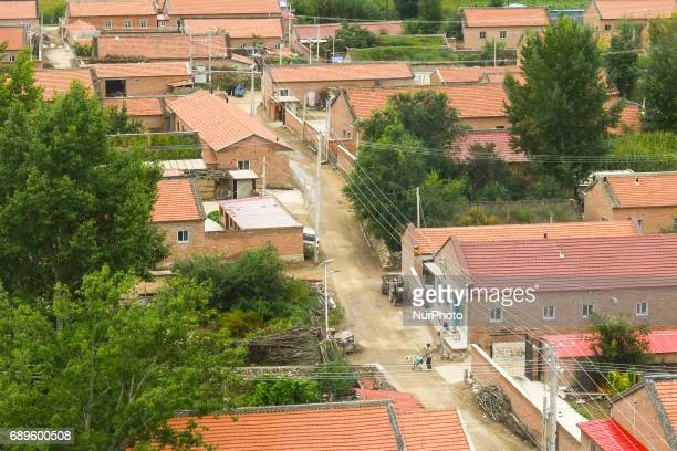 View of a typical village with newly constructed houses along the main motorway crossing Fengning Manchu Autonomous County, in Hebei province,...
