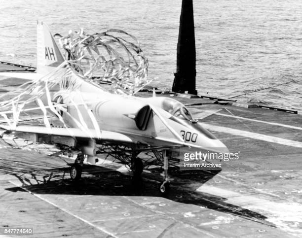View of a US Navy A4 Skyhawk on the deck of the aircraft carrier USS Oriskany Gulf of Tonkin October 20 1967 The plane is tangle in nylon emergency...