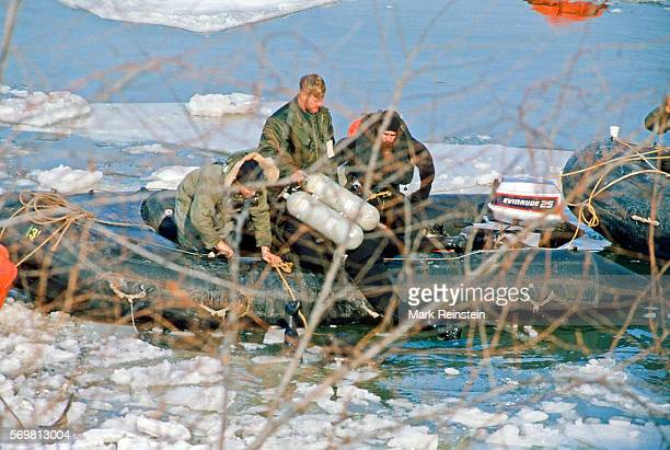 View of a US Navy divers and boat crew on the Potomac River as they aid in the salvage of Air Florida Flight 90 Washington DC January 15 1982 On...