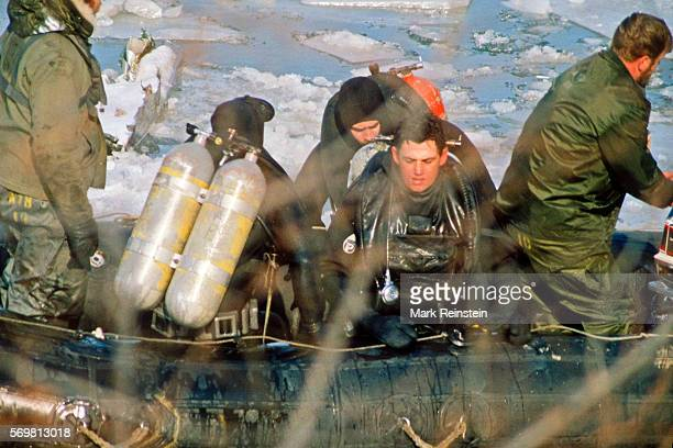 View of a US Navy divers and boat crew othe Potomac River as they aid in the salvage of Air Florida Flight 90 Washington DC January 15 1982 On...