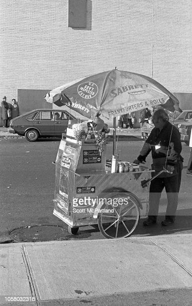 View of a vendor with a hot dog cart on a street in lower Manhattan New York New York September 1980