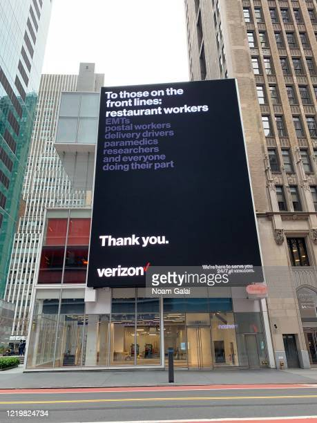 A view of a Verizon billboard thanking frontline workers in Times Square during the coronavirus pandemic on April 19 2020 in New York City COVID19...