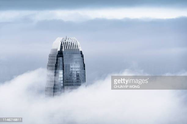 view of a very foggy hong kong - skyscraper stock pictures, royalty-free photos & images