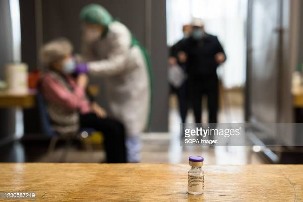 View of a vial of Pfizer-BioNtech COVID-19 vaccine during mass COVID-19 vaccination of people over 80 in Kranj. Voluntary mass COVID-19 vaccination...