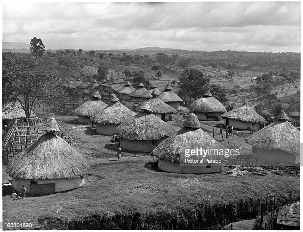 A view of a village consisting of several grass huts in the Kikuyu reserve in Kenya 1955