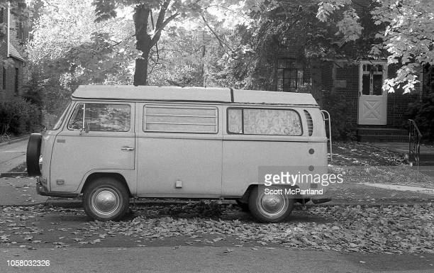 View of a Volkswagen Bus parked on a residential street in Queens New York New York November 1980