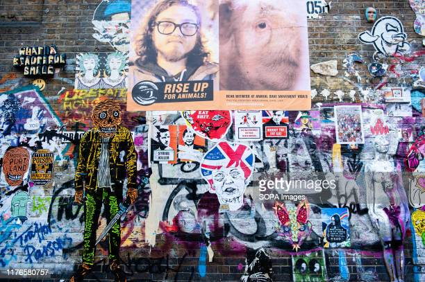 A view of a wall filled with political posters As the Brexit deadline looms new murals and pasteups appear on the streets of London Brick Lane in...