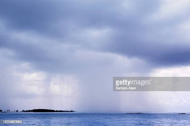 View of a waterspout off the shore of an unspecified island, Bimini, Bahamas, August 1, 2000.