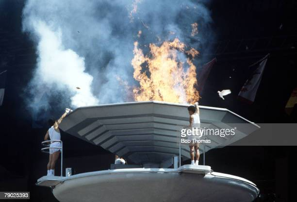 View of a white dove flying in to the air during the lighting of the Olympic flame by athletes in the opening ceremony of the 1988 Summer Olympics...