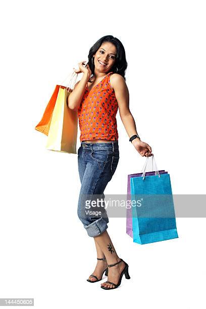 view of a woman holding carry bags - pedal pushers stock pictures, royalty-free photos & images