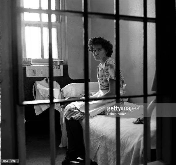 View of a woman sitting on her bed in a jail cell Chicago 1953 Shot at a time when photographers were allowed to bring cameras into jails and...
