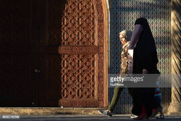 A view of a woman wearing a burka walking inside Fes medina On Saturday July 1 in Fes Morocco