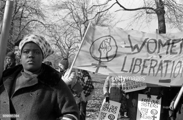 View of a women several with a banner and others with signs in a park during the 'Free Bobby Free Ericka' demonstration cosponsored by the Black...