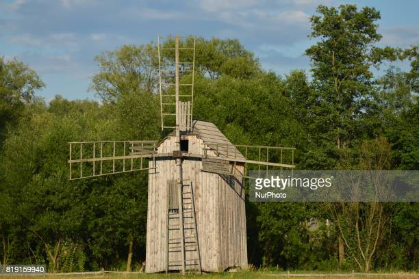 A view of a wooden wind mill inside the Folk Culture OpenAir Museum in Kolbuszowa On Sunday July 16 in Kolbuszowa Poland in Kolbuszowa Poland