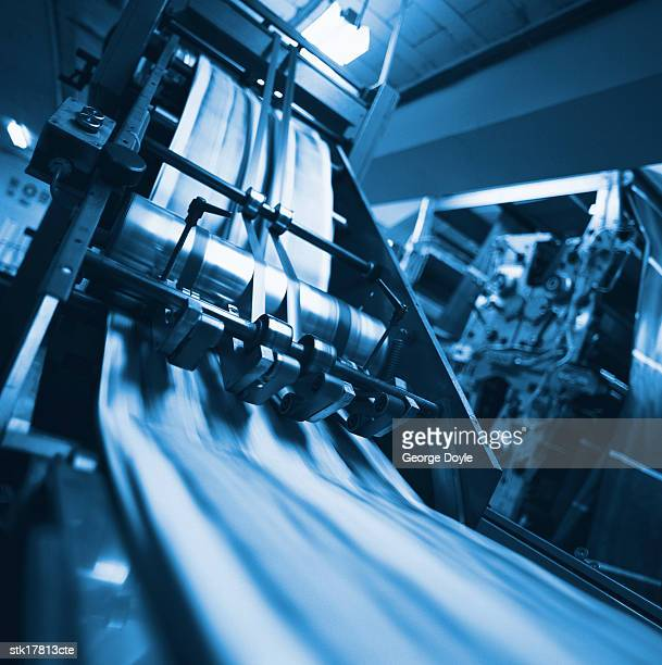 view of a working printing machine in a printing press