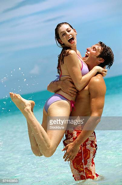 view of a young couple in the water