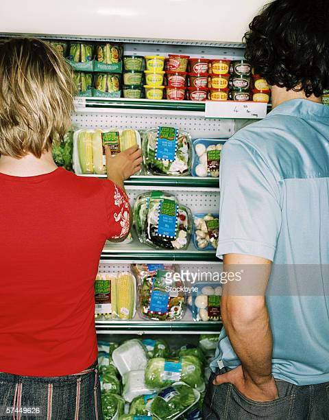 view of a young couple shopping at a supermarket