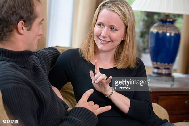 View of a young couple talking in sign language