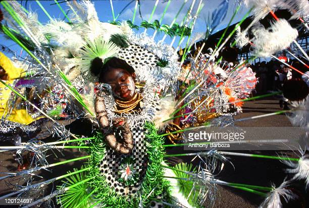 View of a young girl dressed in an elaborate costume while celebrating Carnival in Trinidad 1977
