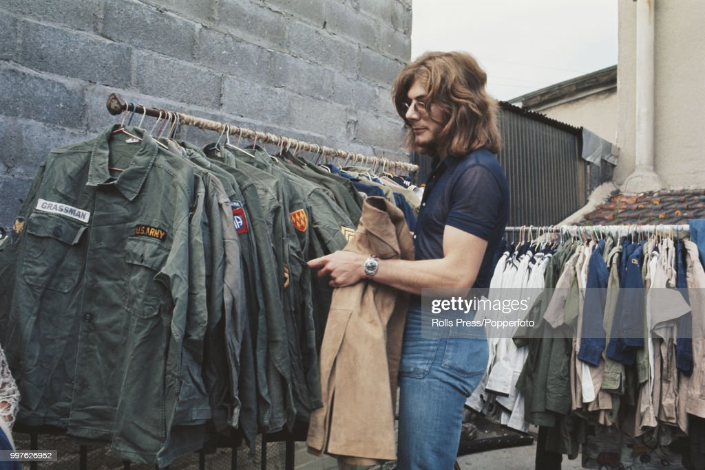 Us Army Surplus >> View Of A Young Man Browsing Through A Rail Of Us Army Surplus