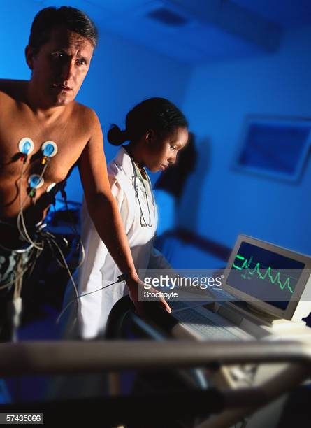 view of a young man getting a treadmill test done