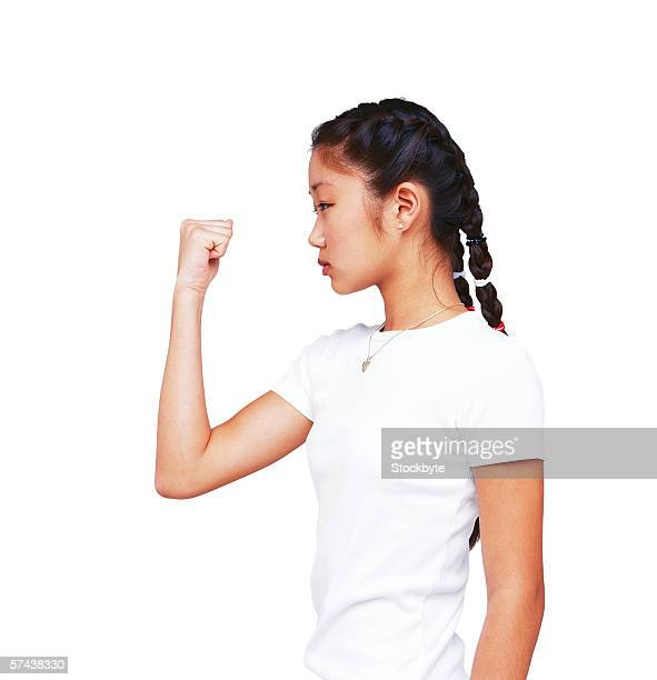 view of a young woman standing with her fist clenched