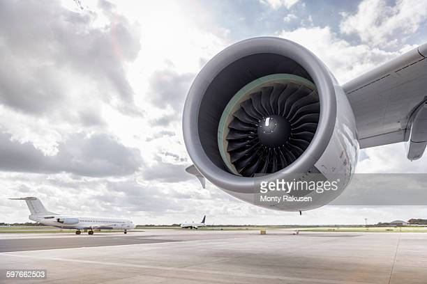 View of A380 aircraft jet engine and planes on runway
