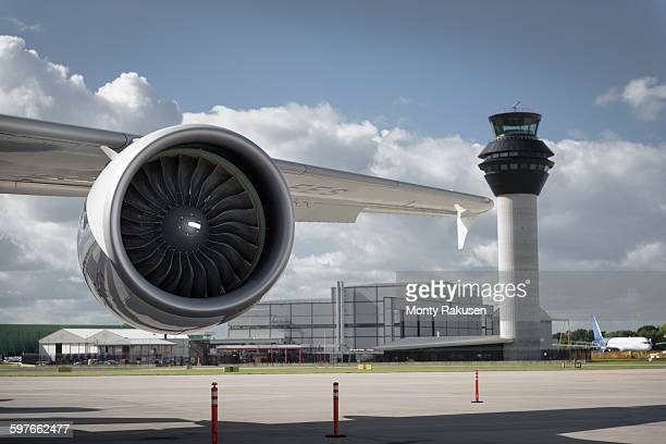 View of A380 jet engine and control tower at airport