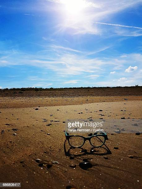 view of abandoned eyeglasses against cloudy sky - obsolete stock pictures, royalty-free photos & images