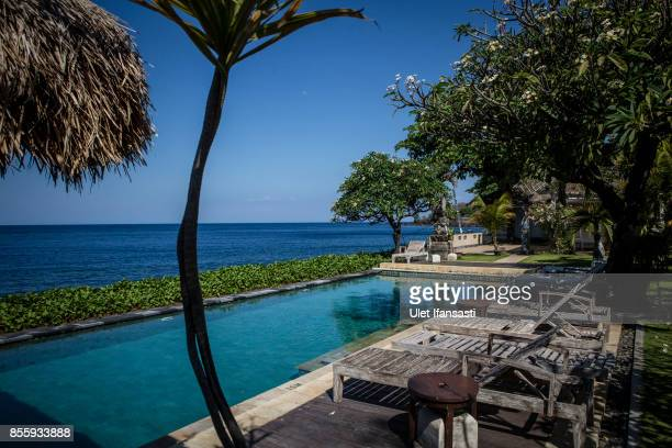 KARANGASEM BALI INDONESIA SEPTEMBER 30 A view of abandoned hotel as emptied of tourists at Tulamben beach on September 30 2017 in Karangasem regency...
