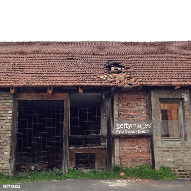 view of abandoned house against clear sky - boban stock pictures, royalty-free photos & images