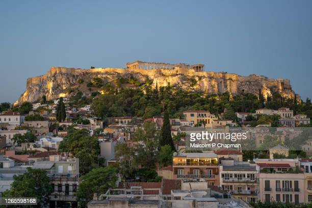 view of acropolis at sunrise from plaka rooftop, athens, greece - アテネ ストックフォトと画像