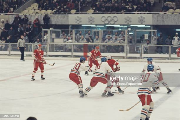 View of action between Czechoslovakia and Japan in the Men's ice hockey tournament at the 1972 Winter Olympics at the Makomanai Ice Arena in Sapporo...