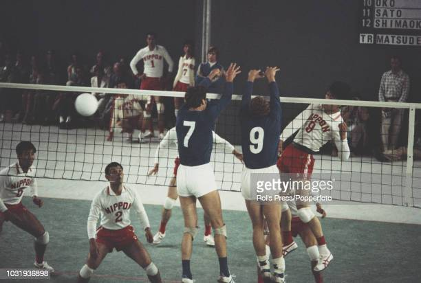 View of action between East Germany and Japan during the final of the Men's volleyball tournament at the 1972 Summer Olympics inside the...